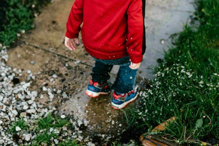 Child playing in rain