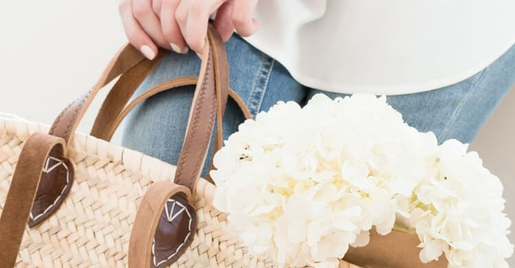 Picture of woman holding bag with flowers