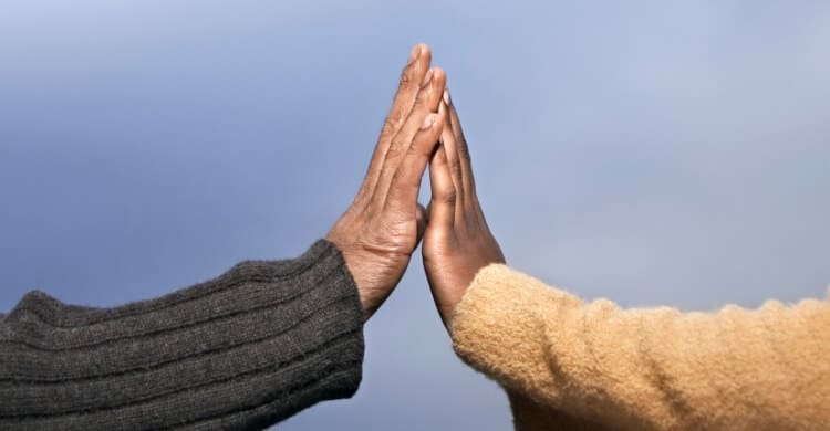 Picture of two people touching hands