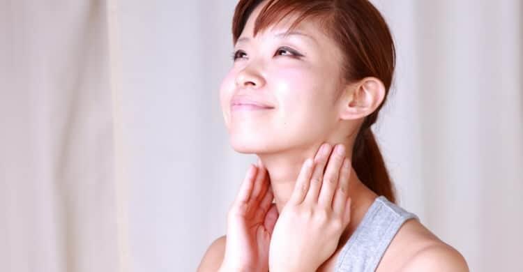 Woman applying self-massage to reduce stress