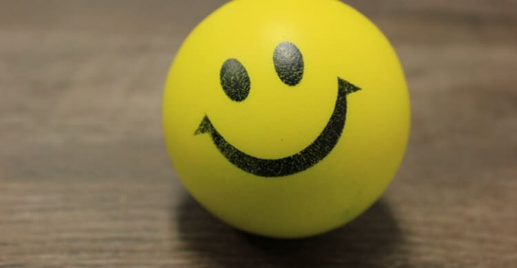 A yellow ball with a happy face on it