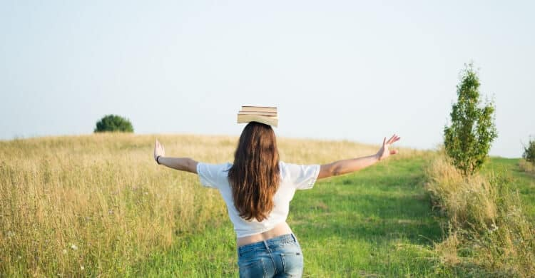 Woman balancing a book on her head