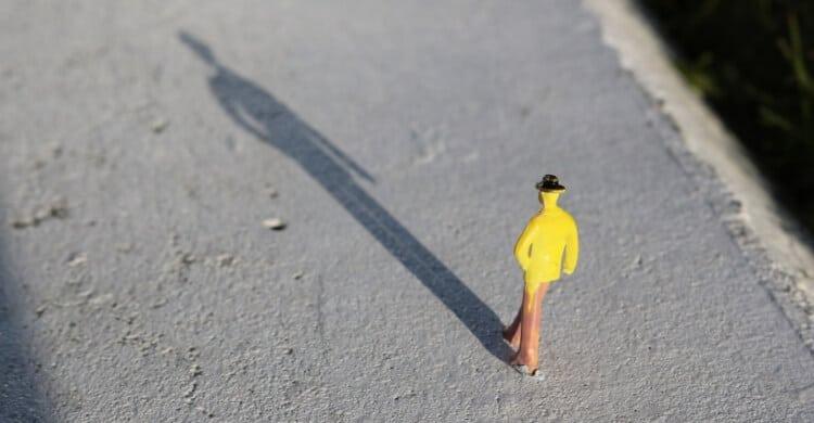 Small man on pavement