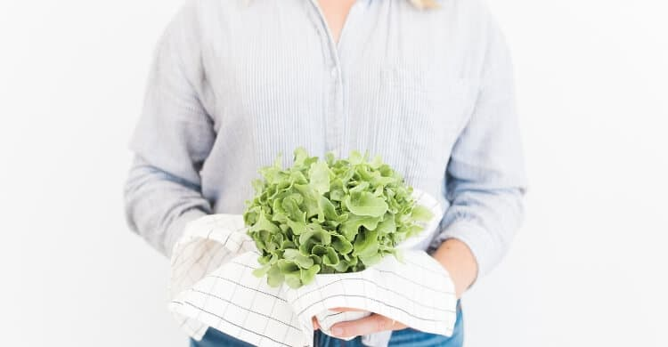 Woman holding fresh greens